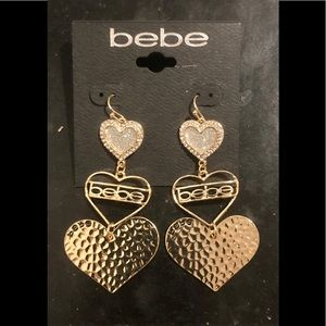 Goldtone bebe dangle earrings